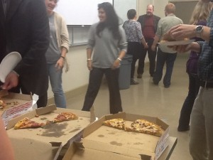 Dr. Hawks talks with students over pizza & cake