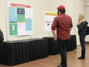 Attendees enjoying the poster session
