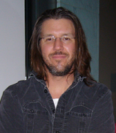 """David Foster Wallace headshot 2006"" by derivative work: Pabouk (talk)The_best_people_you_will_ever_know.jpg: claudia sherman - The_best_people_you_will_ever_know.jpg. Licensed under CC BY-SA 3.0 via Wikimedia Commons - https://commons.wikimedia.org/wiki/File:David_Foster_Wallace_headshot_2006.jpg#/media/File:David_Foster_Wallace_headshot_2006.jpg"