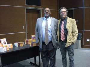 Joseph Graves and Christopher Lynn (author) next to Joe's books, for sale at the ALLELE lecture. Photo by Avery McNeece, 11/10/16.