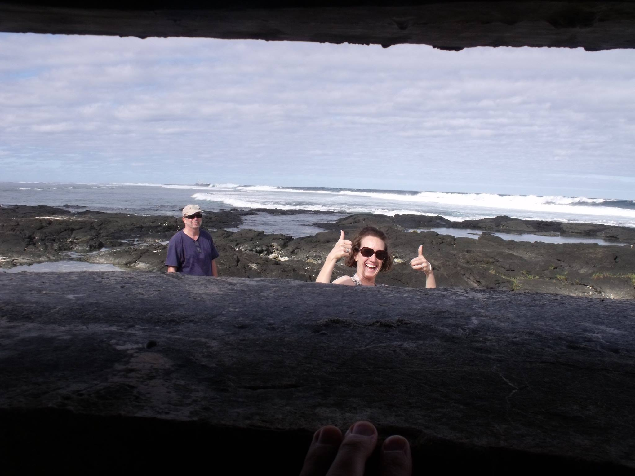 Michaela Howells and David Herdrich, viewed from inside a pillbox next to Pago Pago International Airport.