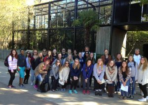 "Students from ""Introduction to Biological Anthropology"" and ""Non-Human Primates"" in front of the gibbon enclosure at Birmingham Zoo, October 2016."