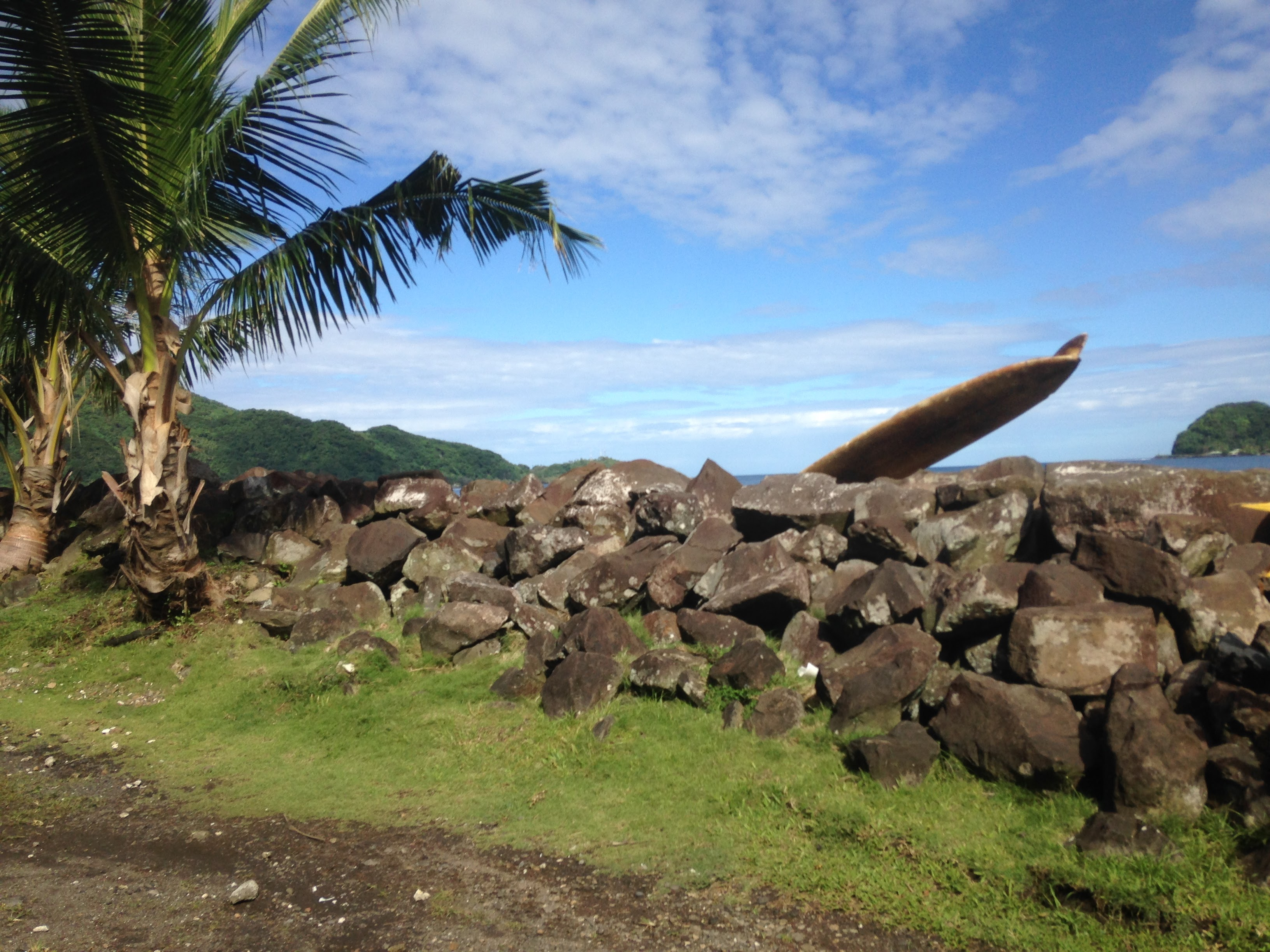 A surf board peeking over a wall near the village of Lauli'i, American Samoa, July 2016.