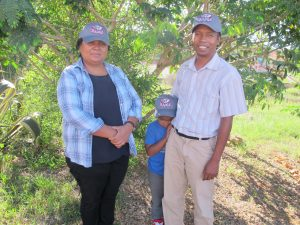 Josia Razafindramanana, her husband Rija Rasamimanana, & their son Hary, Rolling Tide (notice the hats!).